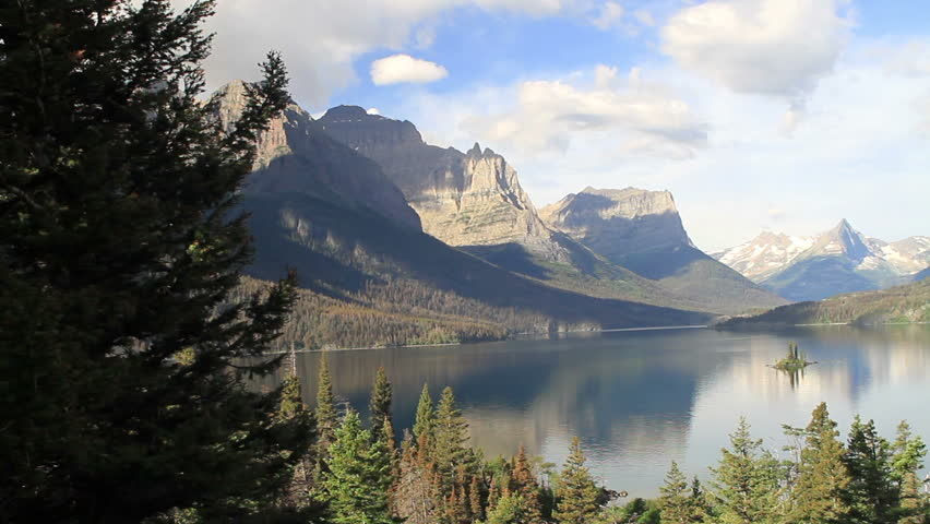 Glacier National Park, Wild Goose Island, St Mary's Lake, Montana. Beautiful sky and clouds. Glacial mountains, lake and forest. Small island in middle of lake.