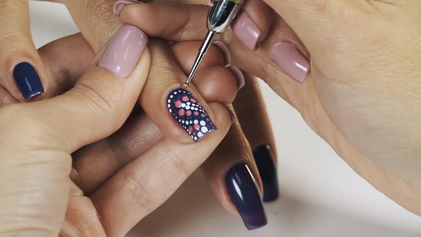 Nail art manicure making nice manicured woman palms stock woman manicurist hand drawing white dots on blue nail polish in beauty shop close up prinsesfo Image collections