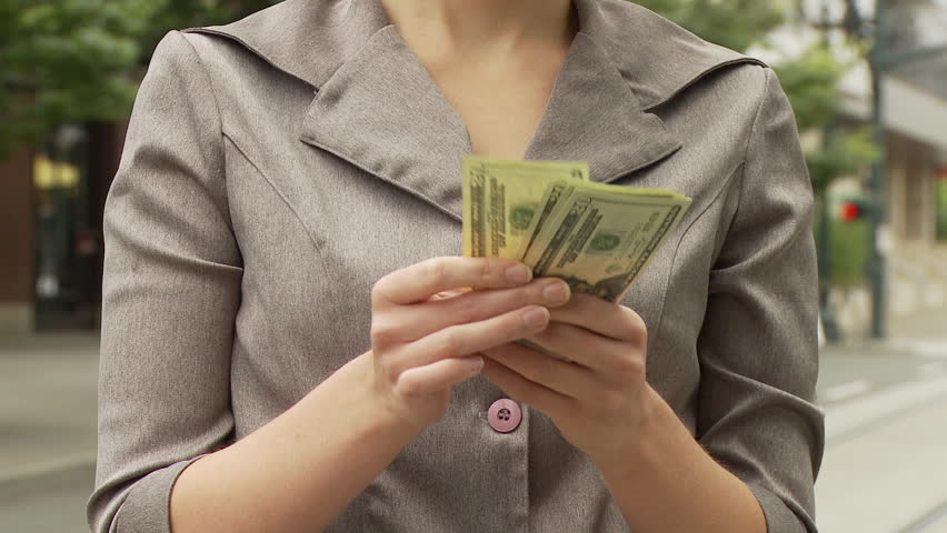 View of a businesswoman counting American money on the street in USA | Shutterstock HD Video #2373224