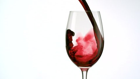 Red wine poured into glass shooting with high speed camera, phantom flex.