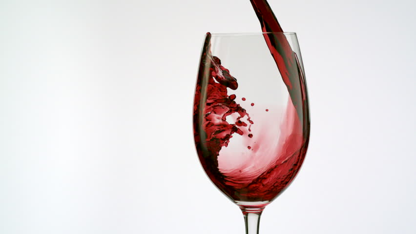 Red wine poured into glass shooting with high speed camera.