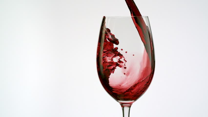 Red wine poured into glass shooting with high speed camera, phantom flex.
