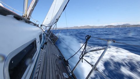 Sailing in the wind through the waves. Sailing boat shot in full HD at the Mediteranean sea.
