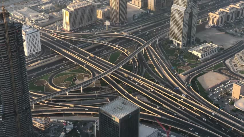 DUBAI, UAE - DECEMBER 2016: Aerial view of traffic intersections. Dubai suffers heavy car traffic. | Shutterstock HD Video #23812750