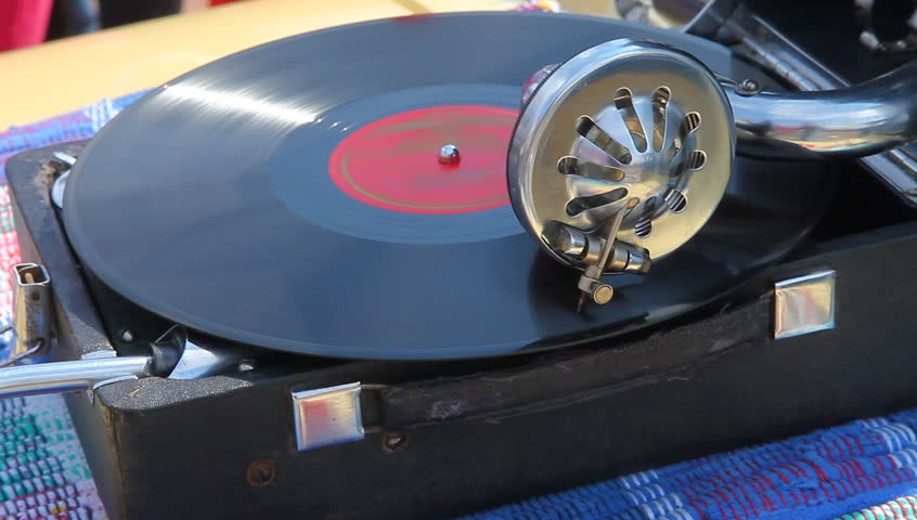 The record player plays old classical music, the portable player of vinyl records.