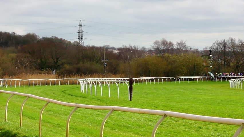 Horses racing around a track
