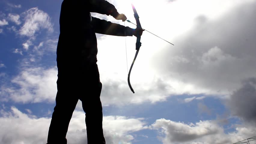 Silhouette of man using bow and arrow | Shutterstock HD Video #23832781