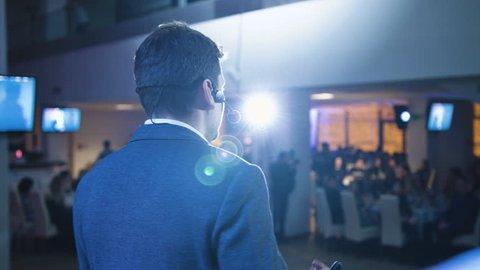 Caucasian speaker teaching at international conference, panning shot