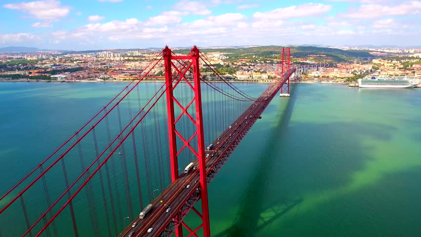 Aerial view over the 25 de Abril Bridge. The bridge is connecting the city of Lisbon to the municipality of Almada on the left bank of the Tejo river, Lisbon