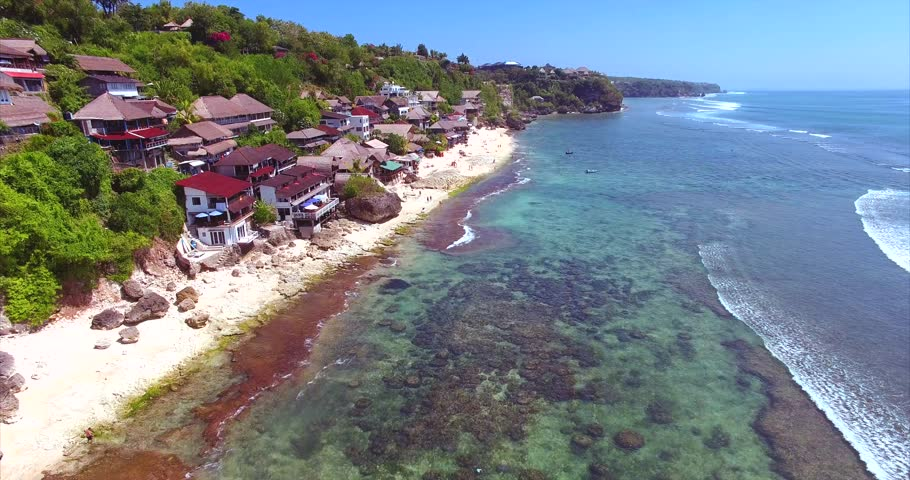Panorama Of Famous Balinese Bingin Beach Rocky Cliffs With Green Tropical Forrest Ocean View
