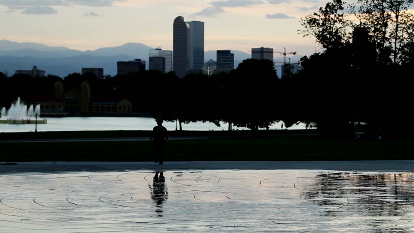Children Playing In A Public Water Fountain With The Denver Colorado Skyline