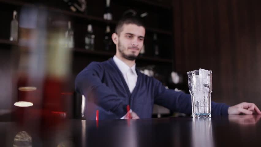 Bartender with shaker making cocktail in modern bar. Handsome barman shake drink.. Handsome barman professional at posh bar making cocktail drinks. #23983822