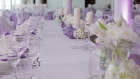 dolly shot of elegant purple and white decoration of a  wedding table