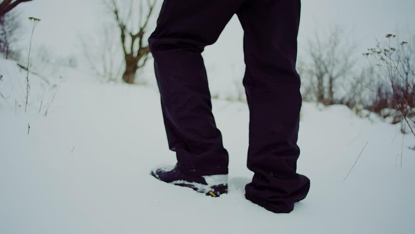 Slow motion. run man with backpack feet steps in snow winter landscape | Shutterstock HD Video #24078994