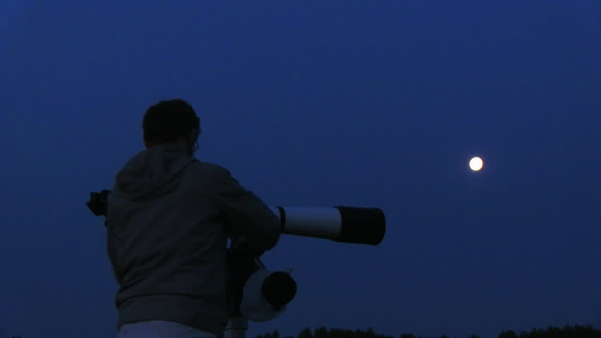silhouette of telescope and astronomer