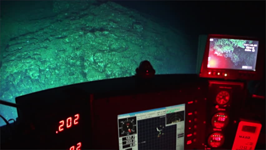 Cocos Island, Costa Rica - 21 September 2015: Life of reefs coral deep sea view from submarine in 300 m depth Pacific Ocean. Extreme diving. Swim in world of unique colorful ecosystem.