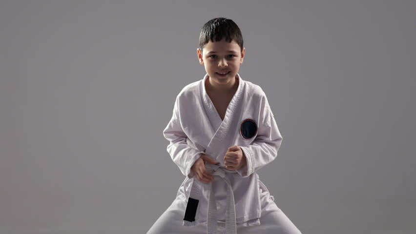 A very energetic seven year old karateka shows a compex from a self defence block and