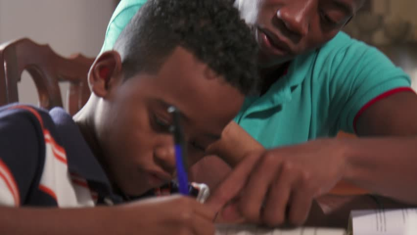 Happy black family at home. African american father and child. Latino dad helping son with school homework. Education and relationship, man teaching and boy learning  #24133024
