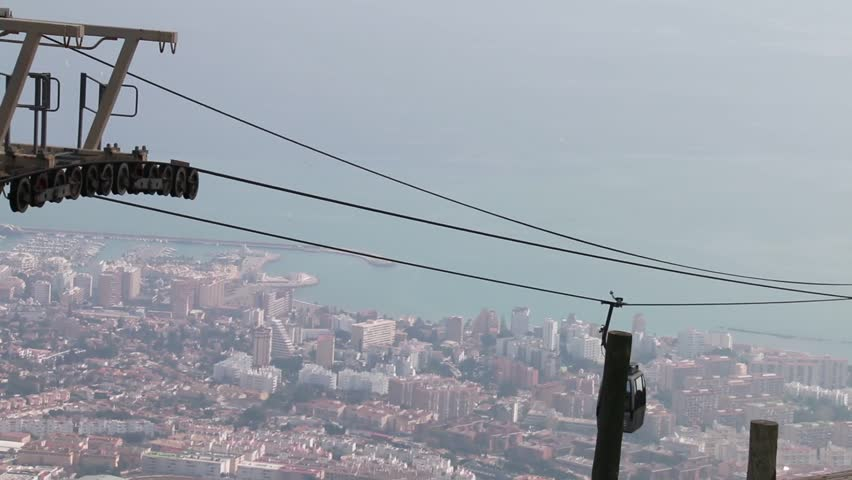 Cable car moving and in the background the city of Benalmadena, on the Costa del Sol, Spain | Shutterstock HD Video #24237734