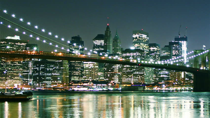 Manhattan skyline and Brooklyn bridge at night. Time lapse and loopable. High quality footage - original size 4k (4096x2304)