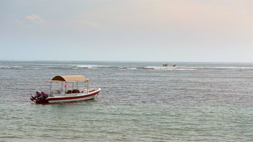 BALI, INDONESIA, Sanur beach - February, 09, 2017: Absenteeism boat in the Bay.