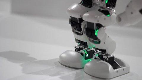 Robot legs dance. Robot dance steps. Close up of robot legs dancing. Science robots. Mechanical technology. Robotic leg. Closeup of humanoid robot foot dance