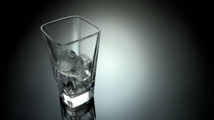 Ice is dropped into glass of Whiskey in slow motion - Stock Video ...