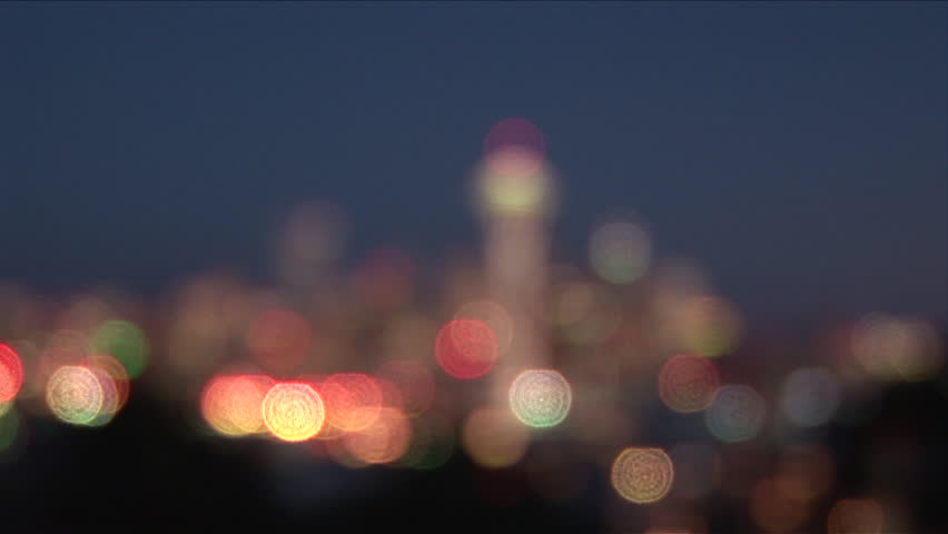 Wide shot with pull focus of Seattle city at night in United States