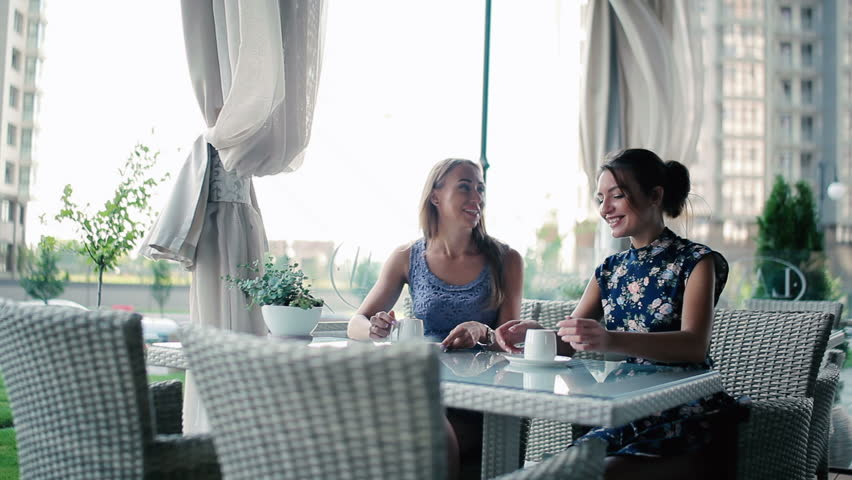Young girls sitting in a restaurant.   Shutterstock HD Video #24285035