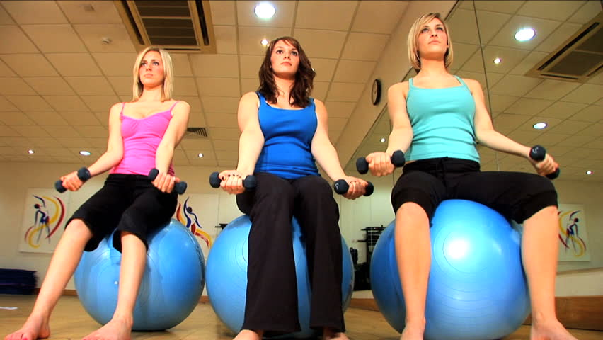 Beautiful girls exercise at the gym