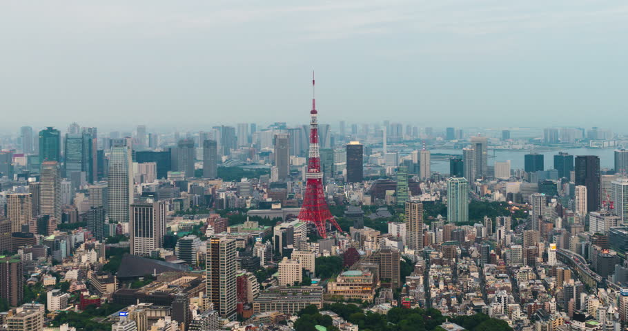 Tokyo, Japan - September 17, 2016: Time-lapse of Skyline with the Tokyo tower at sunset . Tokyo tower is a communications and observation tower located in the Shiba-koen district | Shutterstock HD Video #24303434