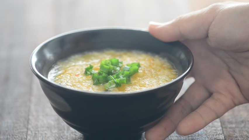 lighting a bowl. Serving A Bowl Grain Porridge On Dining Table, Natural Lighting Background. - HD Stock