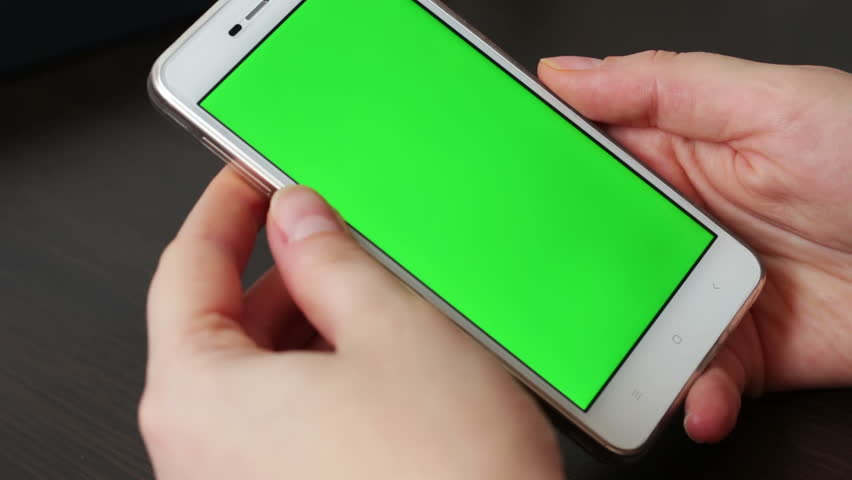 Touch Screen On White Smartphone Green Screen.Using Smartphone,Holding Smartphone with Green Screen | Shutterstock HD Video #24309284