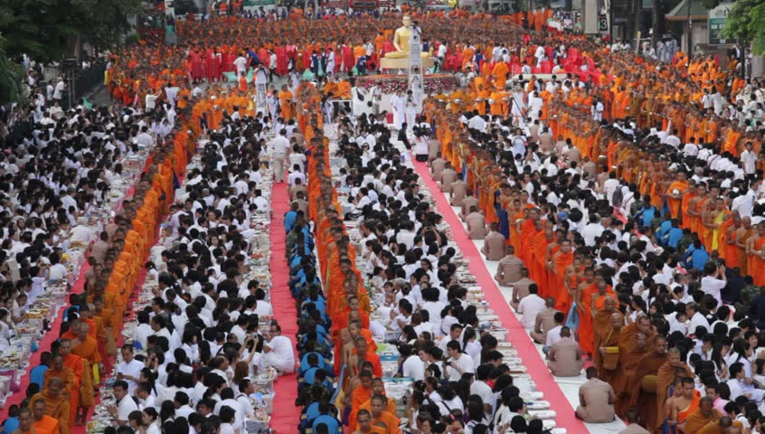 BANGKOK - MARCH 18: Monks are participating in a Mass Alms Giving of 12,600 monks for the Makha Bucha celebrations on March 18, 2012 in Bangkok, Thailand.