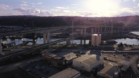 Aerial footage in Seattle March 2013 and West Seattle of industrial highway with cars and sky scrapers in background. 4 k , color corrected.