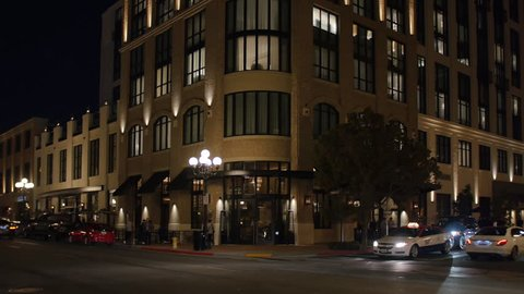 SAN DIEGO, CA - Circa February, 2017 - A nighttime establishing shot of a typical upscale hotel or apartment building on Fifth Avenue in San Diego's Gaslamp Quarter.