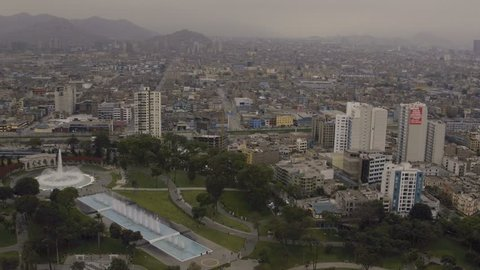 Lima Peru Aerial v14 Flying low over Reserve Park panning with stadium and cityscape views. 12/15