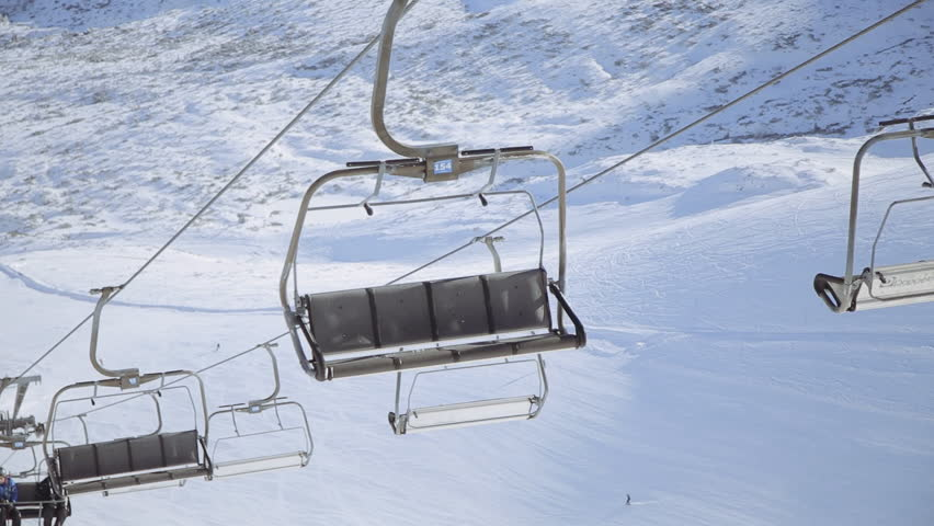 beautiful empty ski lift or chairlift over snow mountain in ski