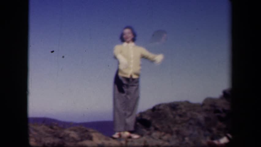 SKYLINE DRIVE VIRGINIA 1943: woman dancing outside on rocks while her friends sit on ground watching her.