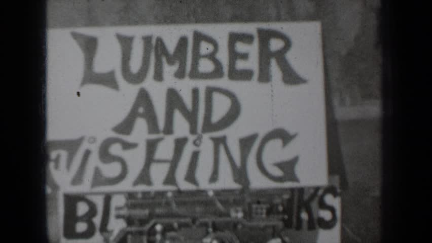 KLAMATH CALIFORNIA 1937: rustic handmade sign posted for business called lumber and fishing | Shutterstock HD Video #24427544