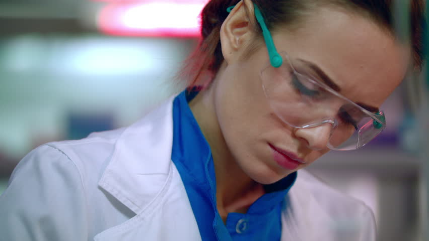 Woman scientist portrait. Female scientist face close up. Serious scientist woman working. Medical scientist thinking. Lab woman face in safety glasses | Shutterstock HD Video #24435224