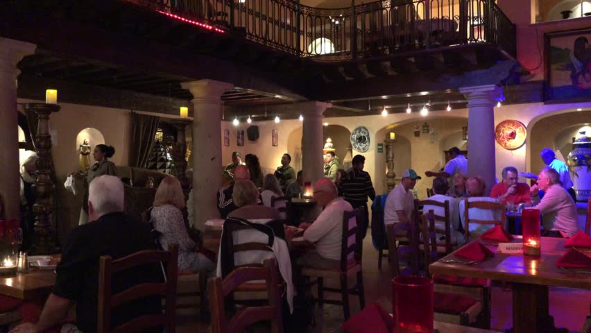 Families eating and socializing at mexican-style restaurant CABO SAN LUCAS MEXICO 2017 | Shutterstock HD Video #24446207