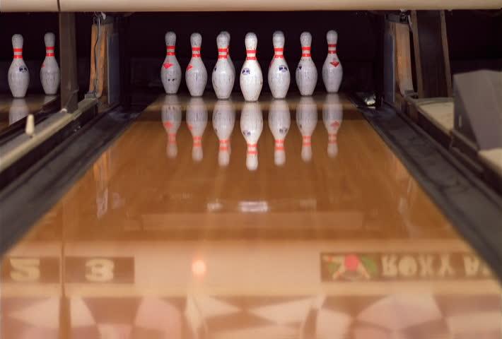 Close-up of a bowling ball making a strike