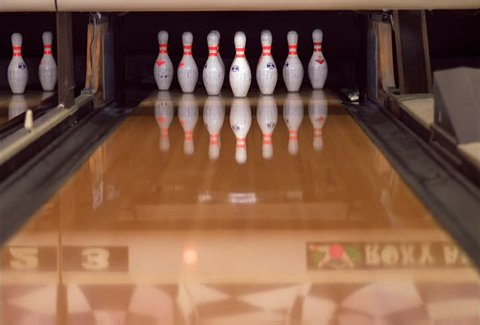 Close-up of a bowling ball making a strike