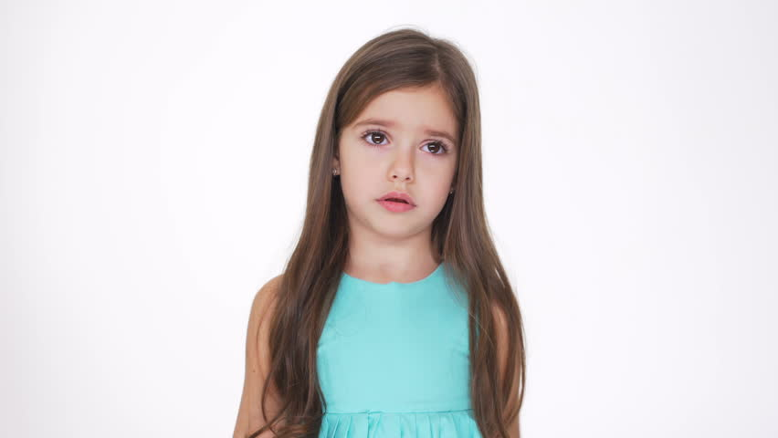 Young Pretty girl in turquoise dress smiling and looking away | Shutterstock HD Video #24471794
