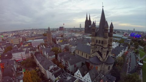 Cologne aerial, fly over Rathaus German City Council, famous travel attraction Cathedral, evening Germany symbols, Western Europe center, tourist sight seeing places, quay, Koln Dom and Opera.