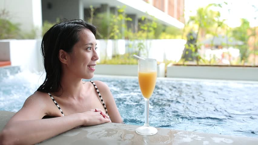 Woman Use Of Cellphone And Enjoy In A Jacuzzi Pool Stock Footage ...