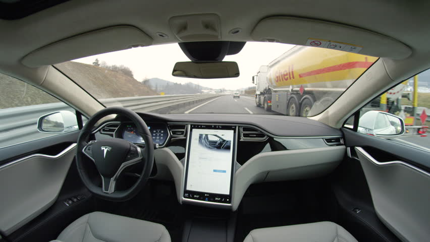 LINZ, AUSTRIA - FEBRUARY 2nd 2017: Absolutely autonomous self-driving autopilot Tesla Model S driverless car with next gen ultrasonic sensors, cameras and radars driving along the busy freeway