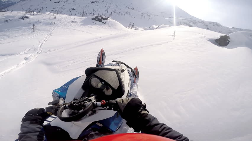 Man falling from a snowmobile in the mountains. Gopro. First person view. Slow motion at moment of falling. | Shutterstock HD Video #24583754