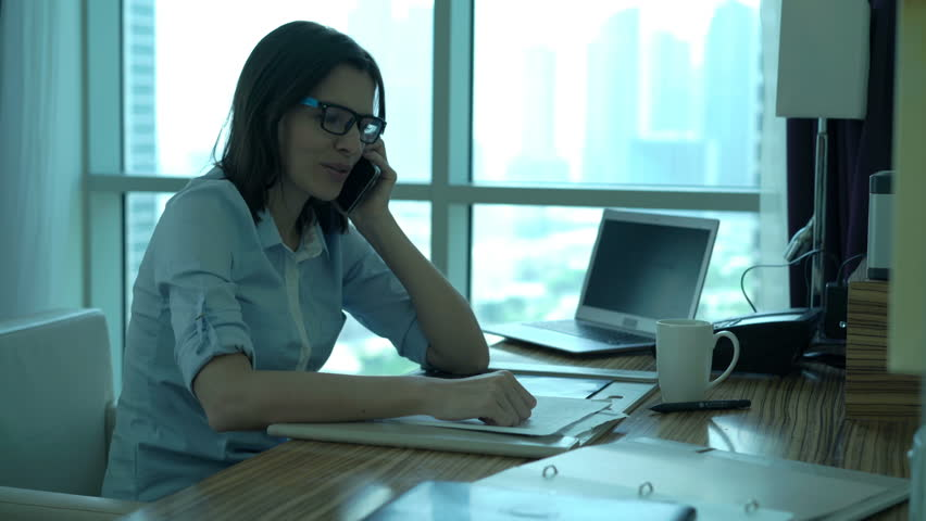 Happy businesswoman getting good news while talking on cellphone in office  | Shutterstock HD Video #24601874